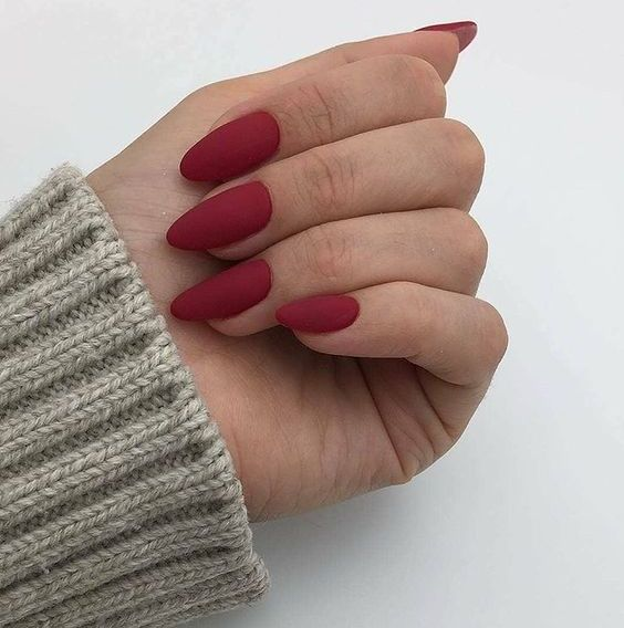 matte red almond nails look very chic and feminine