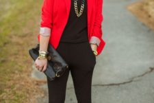 06 a black jumpsuit, black heels and a clutch, a statement chain necklace and a red blazer