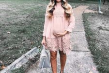 06 a blush lacey dress with long sleeves, a high neckline, grey suede strappy heels and a grey bag