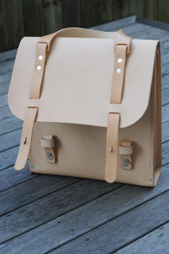 a creamy leather bag with beige leather stripes that wrap from the front to the back is ideal for work