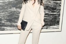 06 a creamy pantsuit with no top and nude shoes is a chic way to make a statement