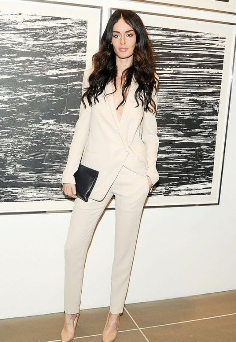a creamy pantsuit with no top and nude shoes is a chic way to make a statement