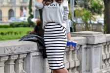 06 a grey printed sweatshirt, a striped pencil knee skirt and bold purple shoes for an accent