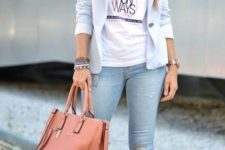 06 a powder blue jacket, a printed tee, blue ripped skinnies, powder blue shoes and a coral bag