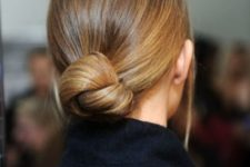 06 a sleek and low sophsiticated twisted low bun is ideal for a strict dress code