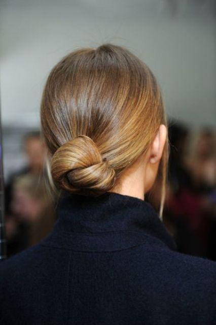 a sleek and low sophsiticated twisted low bun is ideal for a strict dress code