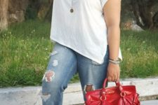 06 a white tee, ripped blue boyfriend jeans, red spiked heels and a red bag
