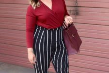 06 black and white pants, a burgundy shirt with long sleeves, striped heels and a plum bag to the office