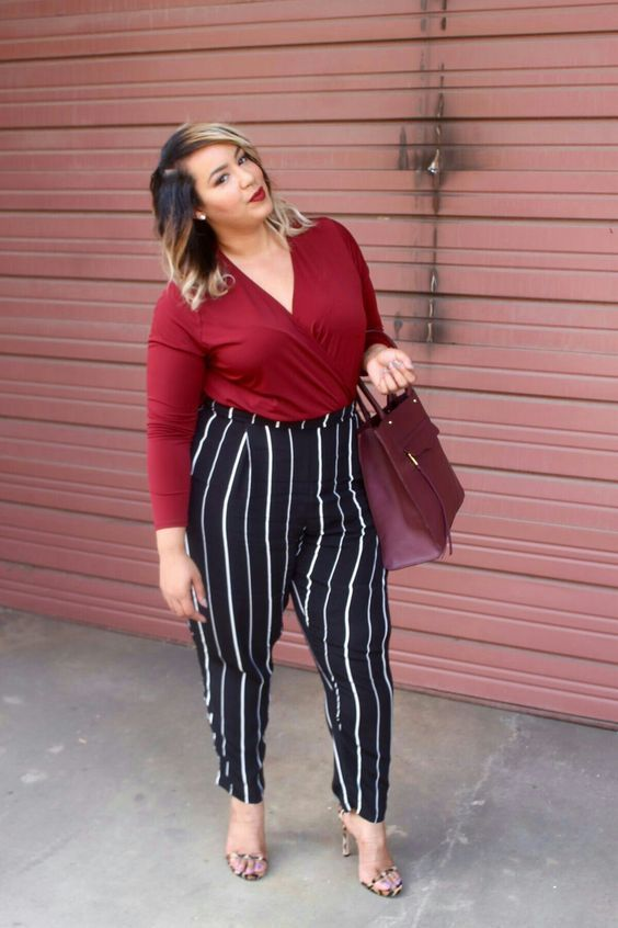 black and white pants, a burgundy shirt with long sleeves, striped heels and a plum bag to the office