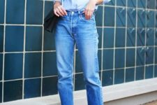07 a blue shirt, blue raw edge jeans, black shoes and a black bag