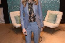 07 a grey pantsuit with a sheer black lace top and grey leather sneakers by Cara Delevigne