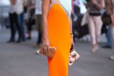 07 a modern catchy dress of white and orange with color blocking, orange shoes and a refined clutch