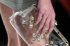 07 a stunning clear clutch decorated with rhinestones will spruce up your party look
