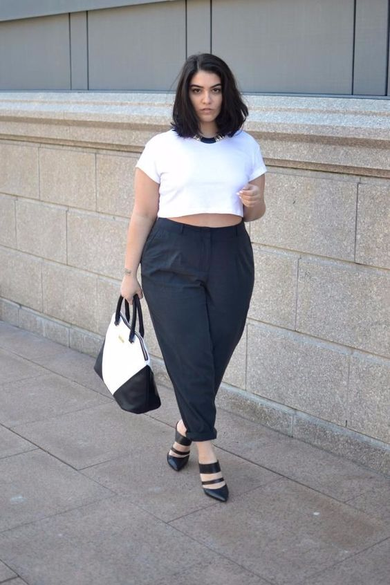 a white crop top, black pants, black shoes and a black and white bag for a casual work look