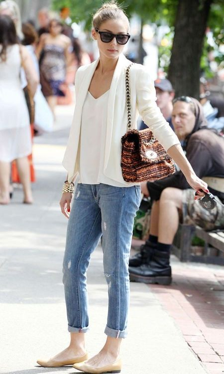 a white top, a white jacket, ripped blue skinnies, neutral flats for a comfy feel