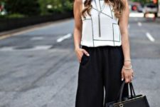 07 black culottes, a geometric black and white top, a black bag and black shoes