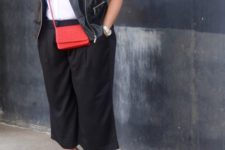 07 black culottes, a white sleeveless shirt, a black leather vest, a red bag and printed heels