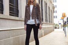 07 black skinnies, black spiked shoes, a lacey white top and a cropped brown jacket