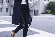 07 ripped black skinnies, a white long sleeve, a navy long vest and heeled sandals