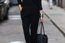 08 a black casual jumpsuit with long sleeves, red shoes and a comfy bag is a stylish idea for work