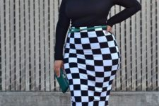 08 a black off the shoulder top, a checked pencil knee skirt, black shoes and a clutch