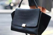 08 a fashionable black leather and suede handbag with a long strap is ideal for many occasions