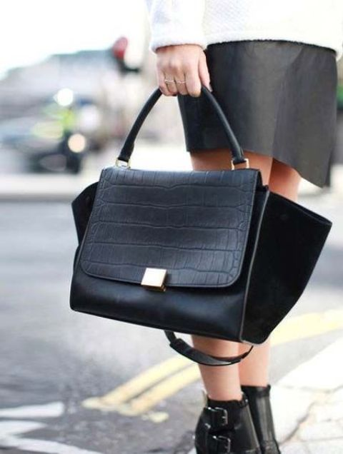 a fashionable black leather and suede handbag with a long strap is ideal for many occasions