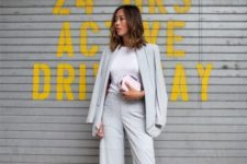 08 a light grey pantsuit with culottes, a white tee, metallic shoes and a clutch