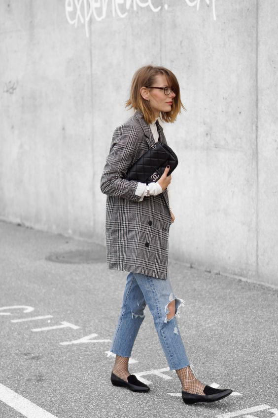 a white vintage shirt, ripped skinnies, net socks, an oversized checked blazer and black flats