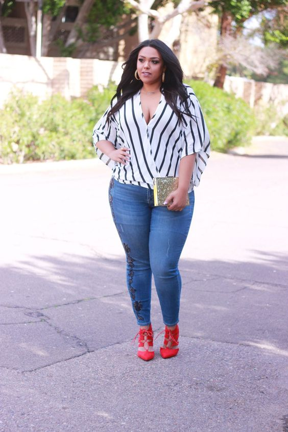 blue embellished skinnies, a striped blouse with a deep V neck and red strappy shoes
