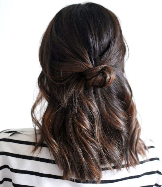 wavy half up half down office hairstyle with a small bun