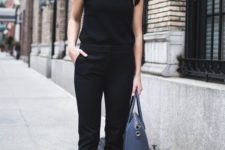 09 a black jumpsuit with a high neckline, ruffled sleeves, black tassel shoes and a blue bag for a casual business look