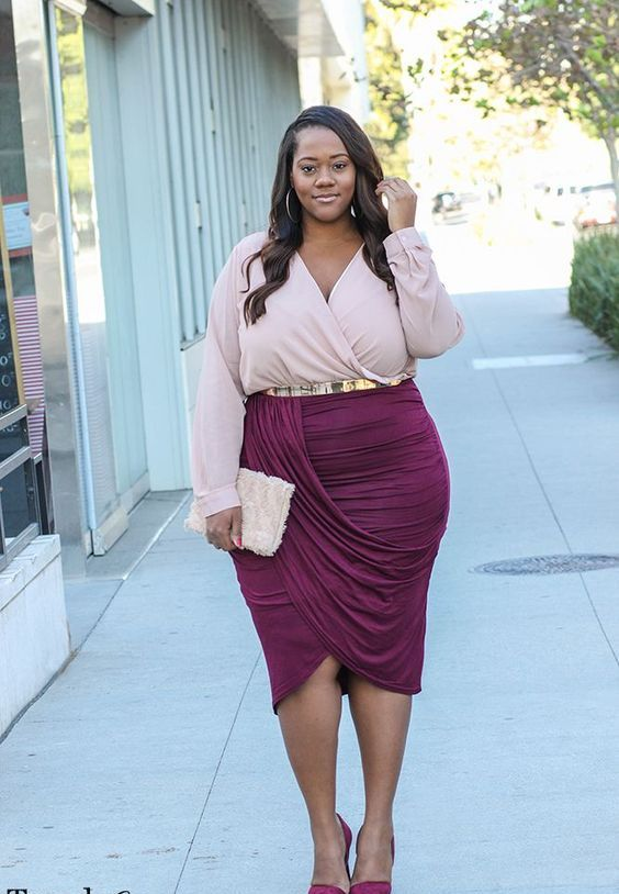 a blush wrap blouse with long sleeves and a V-neckline, a plum wrap skirt and matching shoes for a party