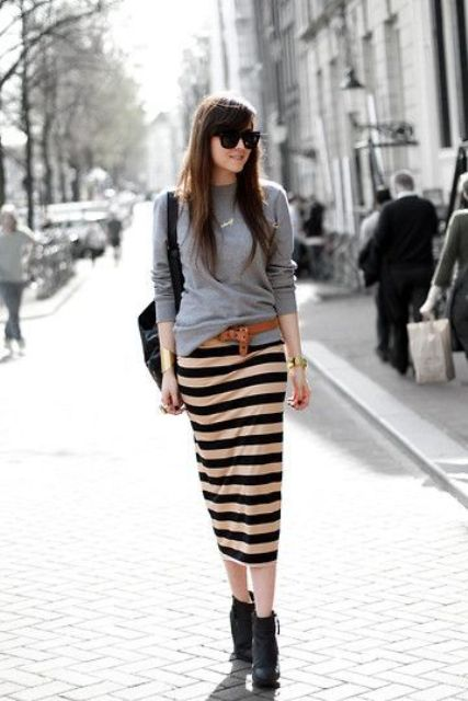 a grey sweatshirt, a striped midi pencil skirt, a leather belt and boots