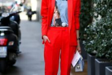 09 a red pantsuit with extra long pants, a printed tee, a statement necklace, a small bag for a street style look