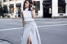 09 a white turtleneck without sleeves, a dove grey midi wrap skirt and matching lacing up mulles