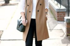 09 black cropped skinnies, a white long sleeve, a camel long vest and black flats