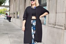 09 floral pants, a black crop top, black shoes and a long cardigan and a statement necklace