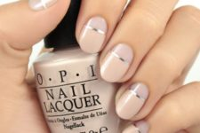 09 nude plus silver stripes negative space manicure for a bold modern look