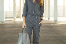 10 a casual grey jumpsuit with long sleeves, a ash with a buckle, a grey bag and white sneakers for a casual work look