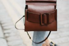 10 a gorgeous warm brown leather bag with an oversized buckle and strap plus handles