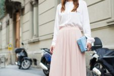 10 a white blouse, a blush pleated midi, a printed blue clutch and purple striped shoes