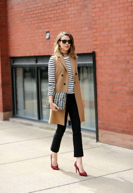 black cropped jeans, a striped top, a camel long vest and red shoes for a chic and comfy look