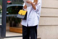 10 black culottes, a long white shirt, metallic heels and a color block bag for a creative job