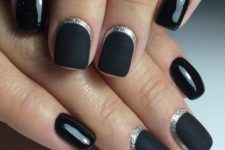 10 black matte nails with silver moon framing and some glossy black nails
