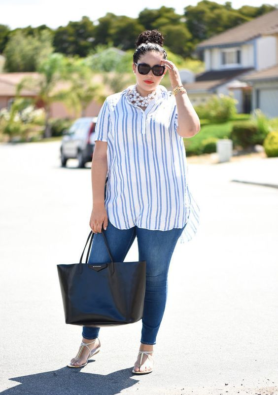 blue jeans, a striped oversized shirt, a statement pearl necklace and sandals for a seaside look