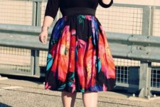 11 a black sleeve top, a bold floral A-line skirt, black strappy heels for a sexy look