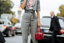 11 a grey plaid pantsuit with a cropped jacket, blakc heels and a red bag for a catchy modern look