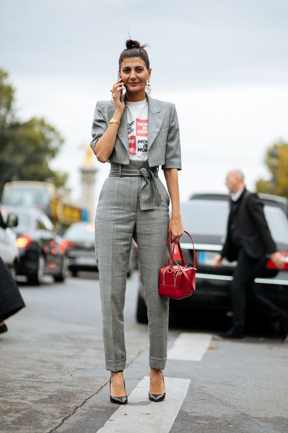 a grey plaid pantsuit with a cropped jacket, blakc heels and a red bag for a catchy modern look