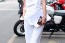 11 a minimal chic look with a white spaghetti strap jumpsuit, nude shoes and a bold lip